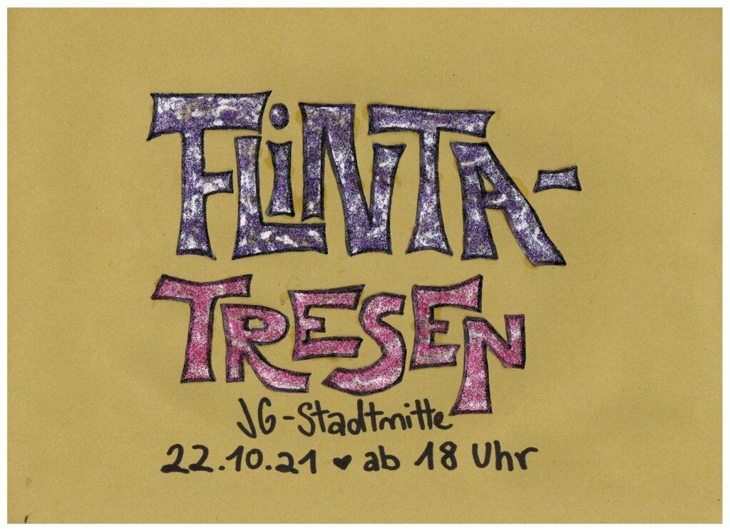 Das Bild zeigt handgeschriebenem Text: FLINTA-Tresen in glitzerndem Lila und Rosa, darunter steht JG Stadmitte, 22.10.21 ab 18 Uhr